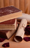 Old books on table on wooden background — Stok fotoğraf