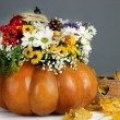 Beautiful autumn composition in pumpkin with decorative box on table on gray background — Stock Photo