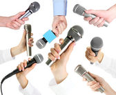 Collage of hands with microphone isolated on white — ストック写真