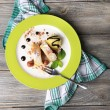 Tasty homemade apple strudel with nuts, mint leaves and ice-cream on plate, on wooden background — Stock Photo #48322305