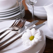 Set of white dishes on table on brown background — Stock Photo #48325077