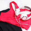 Sport clothes, shoes and headphones on white carpet background. — Stock Photo #48329705