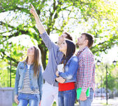 Happy students in park — Foto de Stock