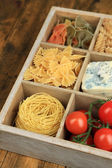 Italian products in wooden box close-up — Stock Photo