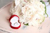 Beautiful wedding bouquet on   wooden chair on light background — Stock Photo