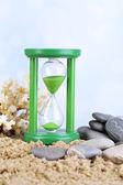 Hourglass in sand — Stock Photo