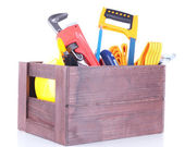 Wooden box with different tools, isolated on white — Stock Photo