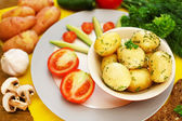 Young boiled potatoes with vegetables on table, close up — Stock Photo