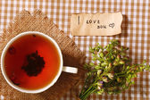Cup of fresh herbal tea on table — Stock Photo
