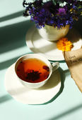 Cup of fresh herbal tea on table — Стоковое фото