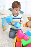 Cute little boy playing in room — Stock Photo