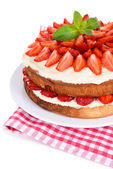 Delicious biscuit cake with strawberries isolated on white — Stock Photo