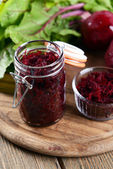 Grated beetroots in jar on table close-up — Stock Photo