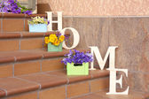 Stair steps decoration with wildflowers and decorative letters — Stock Photo