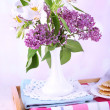 Light breakfast and beautiful bouquet on bed — Stock Photo #48368103