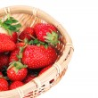 Ripe sweet strawberries in wicker basket, isolated on white — Stock Photo #48368385