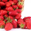 Ripe sweet strawberries in wicker basket, isolated on white — Stock Photo #48368387