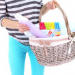 Woman holding laundry basket with clean clothes, towels and pins, isolated on white — Stock Photo #48369641