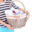 Woman holding laundry basket with clean clothes, towels and pins, isolated on white — Stock Photo #48369659