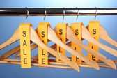 Wooden clothes hangers as sale symbol — ストック写真