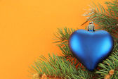 Beautiful Christmas toy on fir tree — Stockfoto