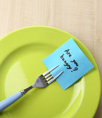 Note paper with message  attached to fork — Foto de Stock