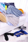 Messy colorful male clothing on  sofa — Stok fotoğraf