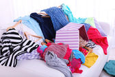 Messy colorful clothing on  sofa — Foto Stock