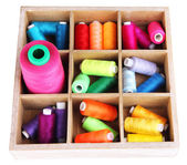 Multicolor sewing threads in box isolated on white — Stockfoto