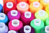 Multicolor sewing threads background — Stok fotoğraf