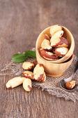 Tasty brasil nuts on wooden background — Stock Photo