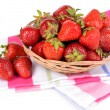 Ripe sweet strawberries in wicker basket isolated on white — Stock Photo #48370675