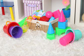 Colorful toys on fluffy carpet in children room — Stock fotografie