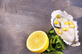 Tasty cooked oyster in shell on wooden table — Stock Photo
