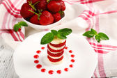 Fresh strawberry with banana on skewers on plate on table close-up — Stock Photo
