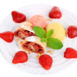 Tasty homemade strudel with ice-cream, fresh strawberry and mint leaves isolated on white — Stock Photo