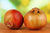 Unripe pomegranates — Stock Photo