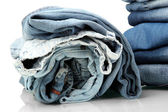 Lot of different blue jeans close-up — Stock Photo