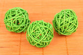 Wicker bamboo balls on bamboo mat — Stock Photo