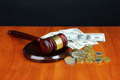 Gavel and money on table on black background — Stock Photo