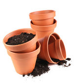 Clay flower pots and soil, isolated on white  — Стоковое фото