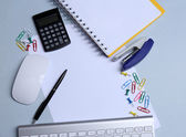Office table with stationery accessories, keyboard and paper, close up — Stock Photo
