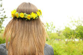 Female hair with crown of dandelions   — Stock Photo
