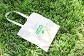 Eco bag on green grass, outdoors — Stock Photo