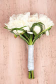 Beautiful wedding bouquet on  color wooden background — Stock Photo