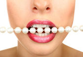 Necklace in teeth, close up — Stock Photo