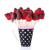 Strawberry in chocolate on skewers in cup isolated on white — Stock Photo