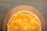 Homemade orange tart on wooden background — Stock Photo