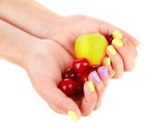 Female hands with stylish colorful nails holding ripe berries and fruit, isolated on white — Stock Photo