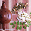 Herbal natural floral tea infusion with dry flowers ingredients, on bamboo mat background — Stock Photo